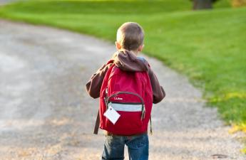 Boy with Red Backpack
